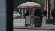 WS Street scene with people around hot dog stand / Manhattan, New York, USA