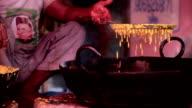 Street seller frying Indian dish