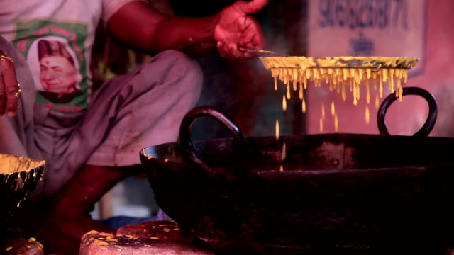Street seller frying Indian dish