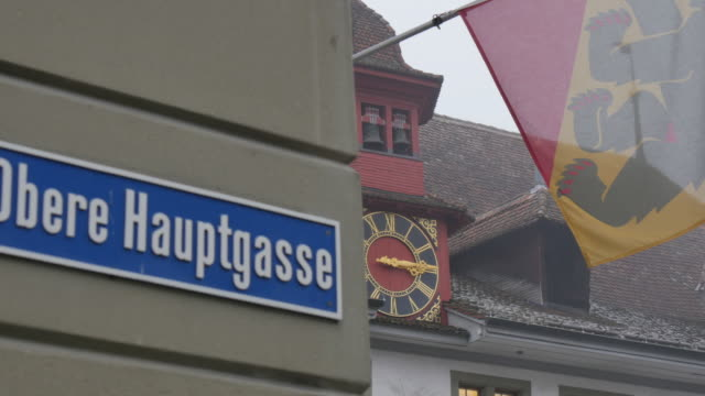 Street sign and architecture on Rathausplatz, Thun, Jungfrau region, Bernese Oberland, Swiss Alps, Switzerland, Europe