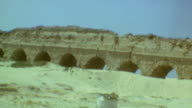 Street signage for Sedot Yam Caesarea and Or Aqiva / Caesarea aqueduct / Crusader City signage / Tourist holding Holy Land map / Crusader Street /...
