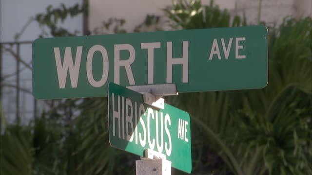 CU Street signs at Worth and Hibiscus Avenues / Palm Beach, Florida, USA