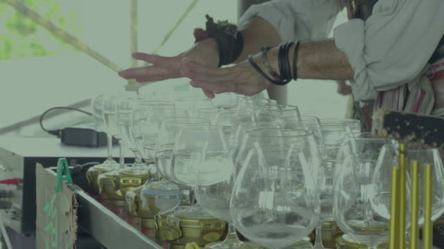 Street sound-artist uses a wineglasses and water only for divine music playing
