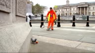 Street sweeper travels Europe sweeping streets for free Various of Bastianelli sweeping up in Trafalgar Square next Trafalgar Square lion statues...