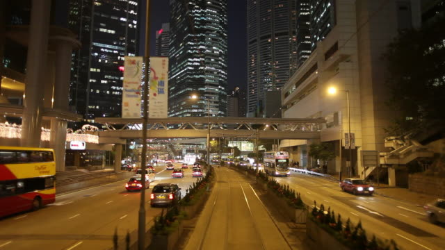 WS POV Street traffic as seen from moving tram / Hong Kong, China