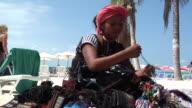 MS Street vendor peddling purses and woven goods, Isla Mujeres, Quintana Roo, Mexico