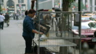 MS PAN Street vendor polishing picture frames / New York City, New York, USA