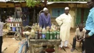 A street vendor sells bottles of petrol on a roadside in N'Djamena Chad on Tuesday Aug 15 2017