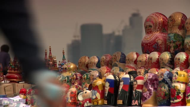 A street vendor sells Matryoshka dolls. Available in HD.