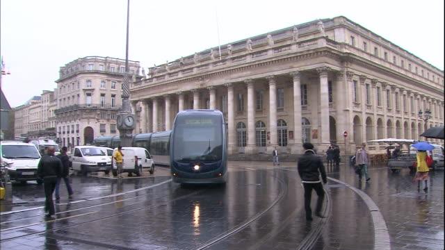 Pan Left A street corner A running streetcar Medium Long Shot