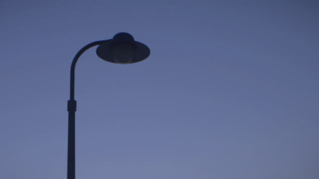 streetlamp comes on at sunset