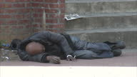 Streetscenes homeless man sleeping on pavement in deprived area Poverty in America on October 02 2012 in Washington DC