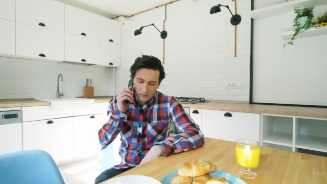 Stressed man talking at mobile phone.