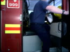 Strike ballot LAMS Firemen down slippery pole on emergency call at fire station MS Driver into driving seat of fire engine EXT LAMS Doors of fire...