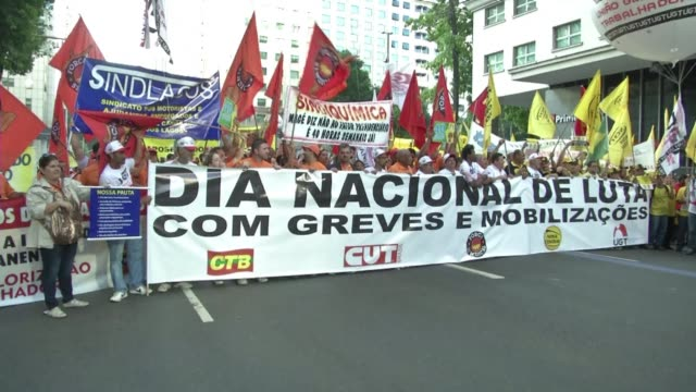 Striking workers blocked key highways and staged peaceful marches across Brazil Thursday in a day of industrial action called by major unions to...