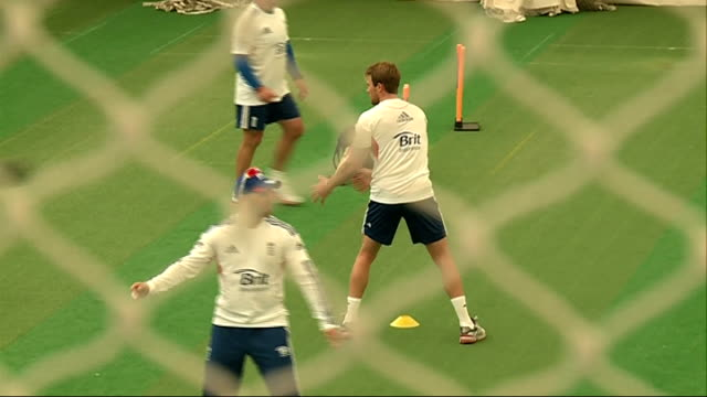Stuart Broad interview and England training More of England cricketers practicing in nets England cricket players passing balls to each other during...