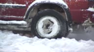Stuck car struggles to drive through snowy road the day after the 5th Largest Blizzard in Chicago history on February 02 2015 in Chicago Illinois