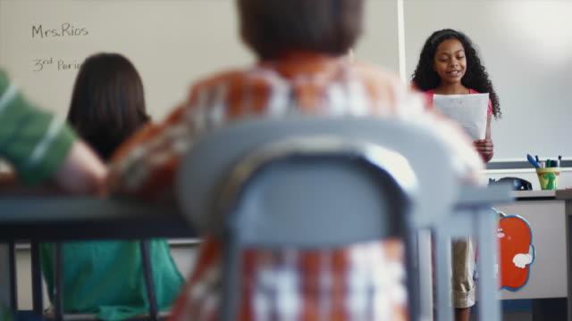 MS PAN Student (8-13) reading report to classmates / Edmonds, Washington, USA