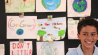 MS TD Student showing recycle project in classroom / Richmond, Virginia, United States