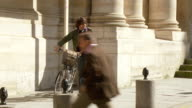 WS Student taking bicycle and cycling up street, Rue de la Sorbonne, Paris, France