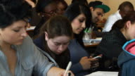 Student uses cellphone to text during lecture