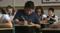 student using a cell phone to cheat