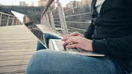 WS Student Using Laptop On Bridge