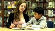 Student with teacher in Library