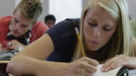 CU DS Student writing notes during classes / Spanish Fork City, Utah, USA