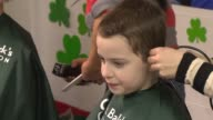 Students a St Cornelius Catholic School getting their heads shaved for the St Baldrick's Foundation on March 07 2014 in Chicago Illinois