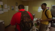 PAN students choosing a cafeteria lunch and having their selections recorded / Marks Mississippi United States