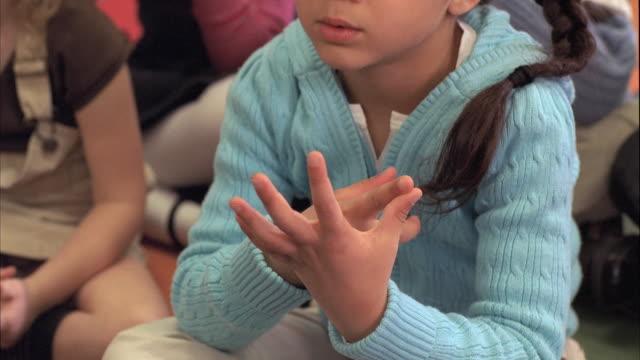 CU Students (5-6) counting on fingers, Oshkosh, Wisconsin, USA