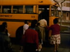 MONTAGE Students crowding to get on brand new school bus / Los Angeles, California, United States