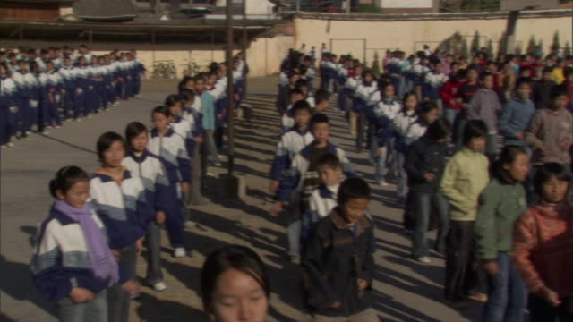 WS PAN Students exercising in front of school, Weishan, Yunnan, China