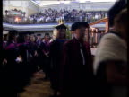 Unknown location Students lining up for degree ceremony and receiving awards