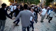 Students from the religious Zionist movement dance in the Rova Jewish Quarter for the 50th Celebration