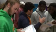 Students get GCSE results amid biggest shake up in years ENGLAND West Midlands Birmingham Ark Kings Academy INT Various of students collecting their...