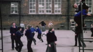 ZO Students having fun on school playground in a self-contained mining operation village / Selby, England, United Kingdom