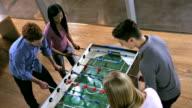 HA Students Having Fun Playing Foosball