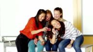 Students looking at smart phone