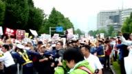 Students mothers and other protesters staged rallies at more than 200 locations across Japan on Sunday calling for the scrapping of controversial...