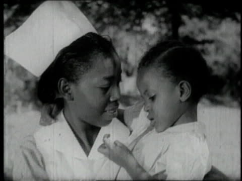 1940 MONTAGE students on campus / Tuskegee, Alabama, United States