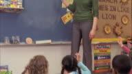 MS TU TD Students (5-6) on floor, teacher writing on blackboard, Oshkosh, Wisconsin, USA