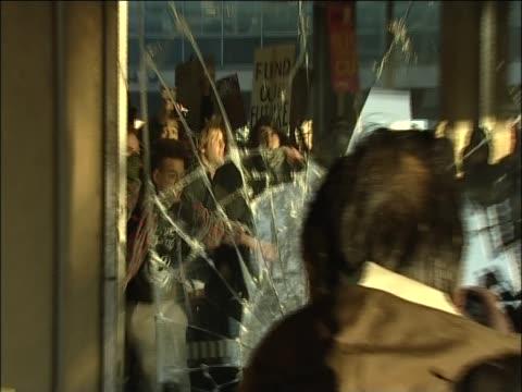 Students smash the window of the Conservative Party headquarters at Millbank Tower in protest against the proposed increases in University tuition...