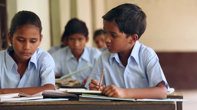 Students studying in the classroom, Haryana, India