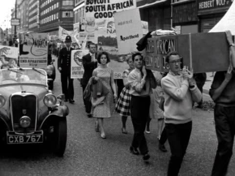 Students take part in a antiapartheid rally through the streets of central London
