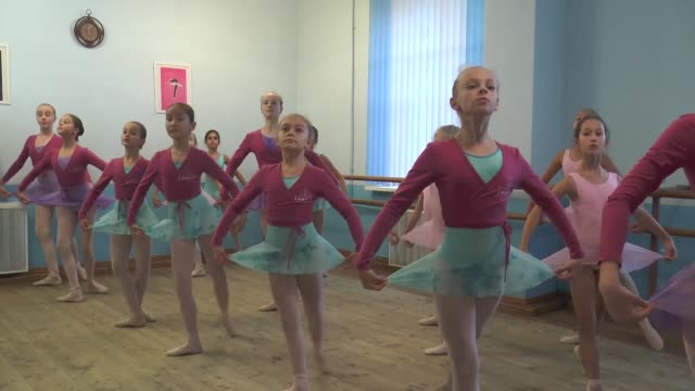 Students take part in a ballet class at Studio Fouette of Elina Nikiforovao in Moscow Russia on October 21 2017 Interviews with Tatiana Martinenko...