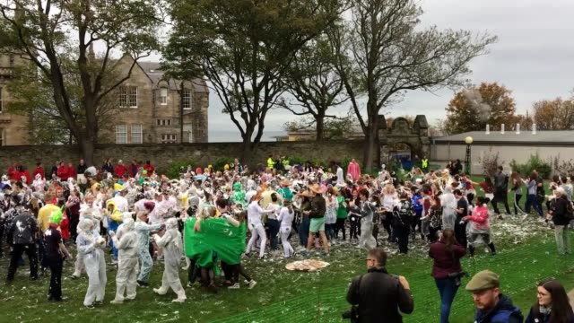 Students take part in a foam fight known as Raisin Monday on Lower College lawn at the University of St Andrews in St Andrews