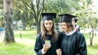 Students taking a selfie on graduation day