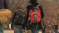 SLO MO MS PAN Students walking at University of Michigan campus / Ann Arbor, Michigan, USA